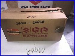 Suzuki GT185 Instrument Assembly Speedometer Tachometer. NOS. 34100-36628
